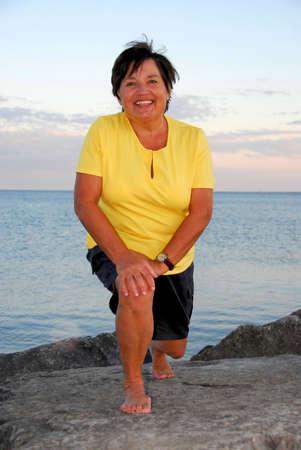 Mature woman exercising outside photo