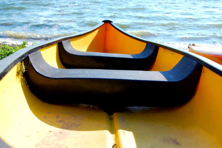 Yellow canoe on lake shore
