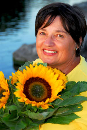 Portrait of a mature woman with sunflowers