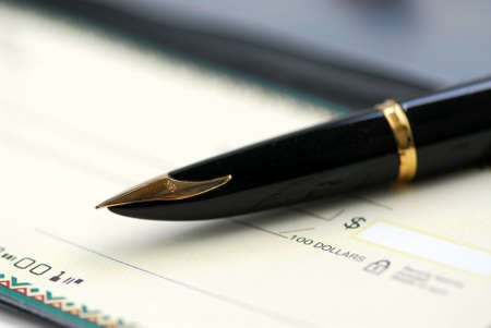 Gold fountain pen and cheque photo