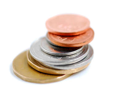Stack of canadian coins on white background photo