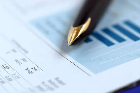 Golden fountain pen on financial chart Stock Photo - 510586