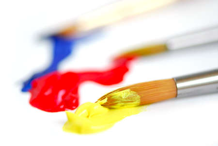 smeared: Macro of paintbrushes with paint of primary colors Stock Photo