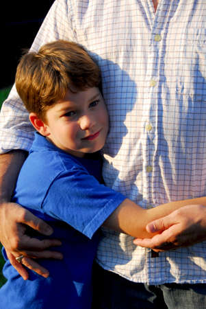 Little boy hugging his father Stock Photo - 522307