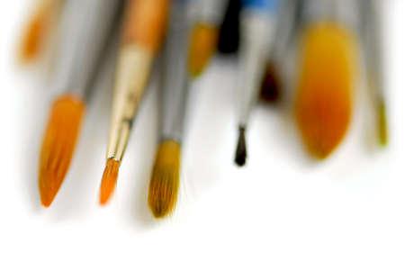 Macro of paintbrushes on white background photo