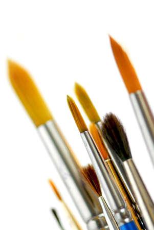 Closeup of paintbrushes on white background photo