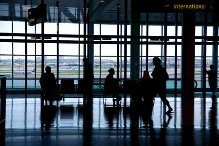 People waiting at the airport terminal Stock Photo - 532701