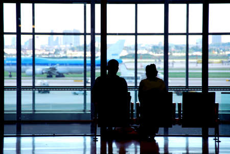 Couple waiting at the international airport terminal