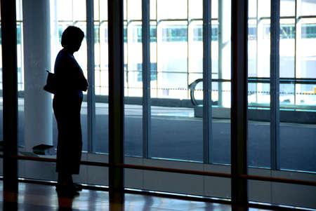 Woman waiting at the international airport terminal Stock Photo - 532695