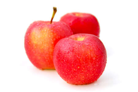 Three red apples with water droplets on white background, focus on the front apple Stock Photo - 541308