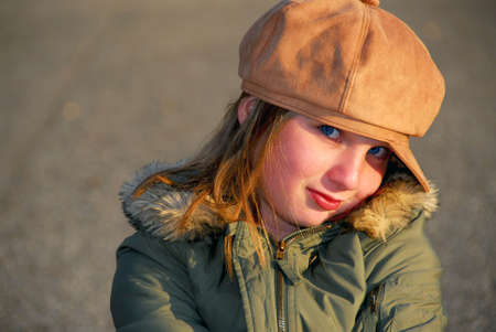 coy: Portriat of a coy smiling girl in winter or fall clothes outside