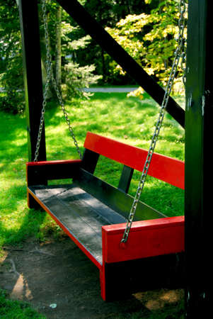Bench swings at forest cottage photo