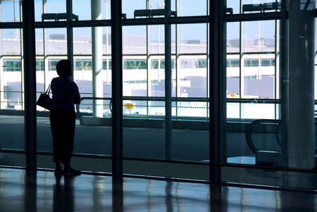 Woman waiting at the international airport terminal Stock Photo - 546799
