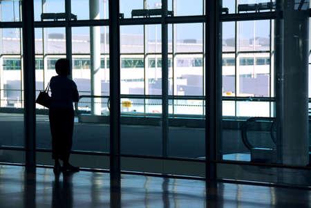 Woman waiting at the international airport terminal Stock Photo - 546799
