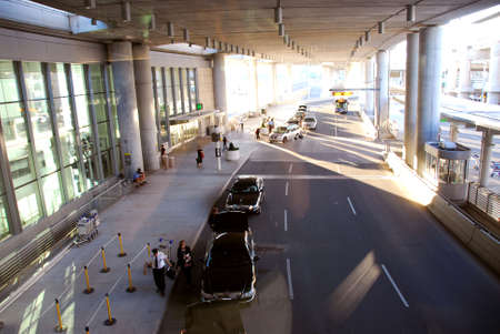 Travelers getting taxis at airport photo