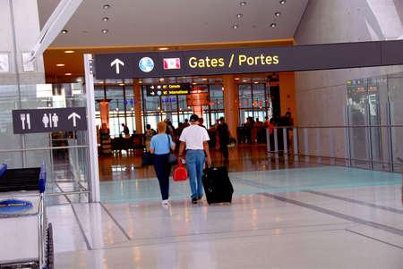 People walking towards gates at modern internation airport photo