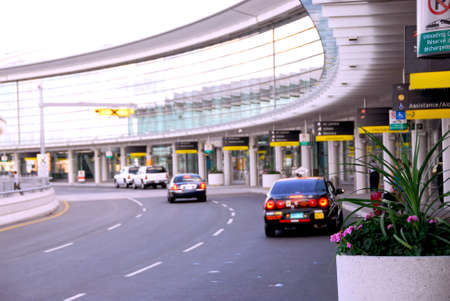 off: Airport terminal with cars outside