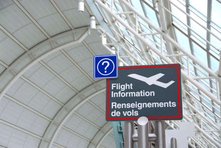 bilingual: Flight information sign in international airport