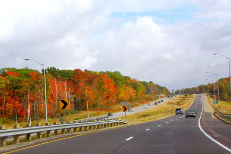 Divided highway with traffic in the fall Stock Photo - 552569