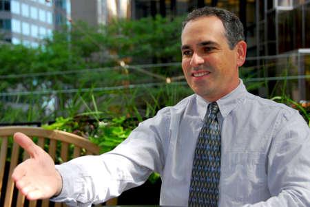 extending: Businessman extending his hand to strike a deal Stock Photo