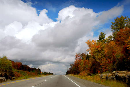 Divided highway in the fall, some motion blur on the sides Stock Photo - 557767