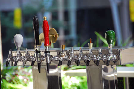 bar: Cold sweating beer tap in outdoor bar Stock Photo