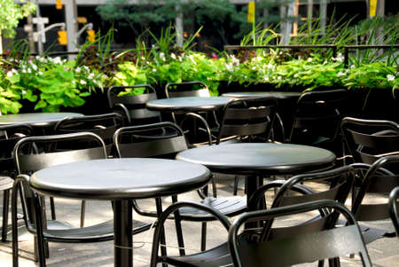 Restaurant outdoor patio with black patio firniture photo