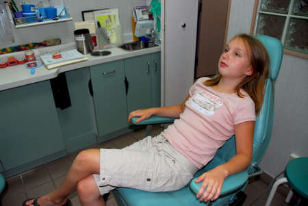 Young girl waiting in a dental office