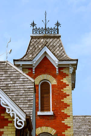 Fragment of a beautiful red brick victorian house photo