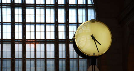 rushing hour: Big clock inside a train station with big window