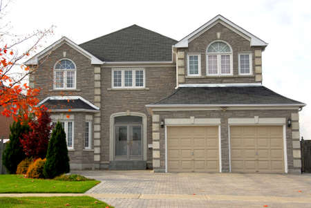 New detached single family luxury home with stone facade Stock Photo - 578125