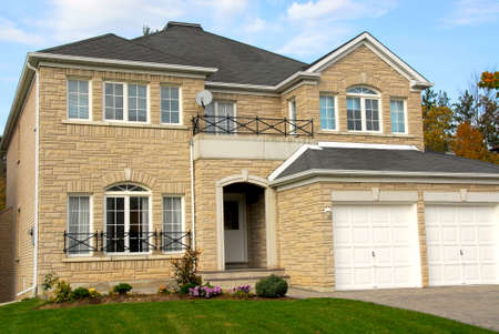 New detached single family luxury home with stone facade and double garage Stock Photo - 578126