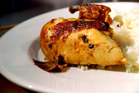 Dinner of roasted chicken and white rice