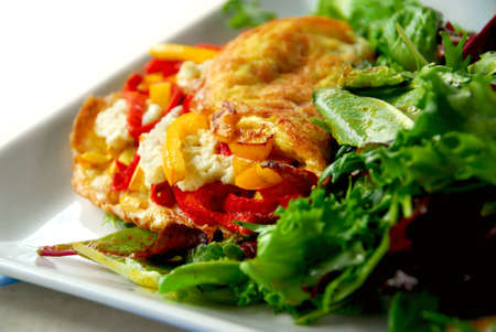 Freshly made omelette served with green salad