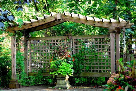 structure: Lush japanese garden with wooden gate structure Stock Photo