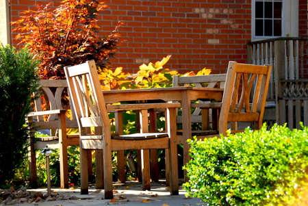 House patio with natural wooden patio furniture Stock Photo - 582862