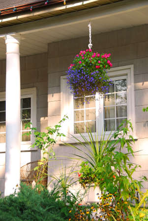 Porch of a cozy house with blooming flowers 版權商用圖片