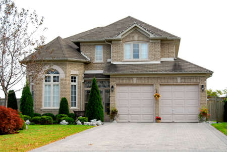 detached: New detached single family luxury home with brick facade Stock Photo