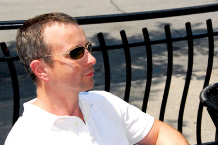 Portrait of a man wearing sunglasses in outdoor cafe photo