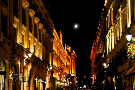 Illuminated street in Paris France with bright moon
