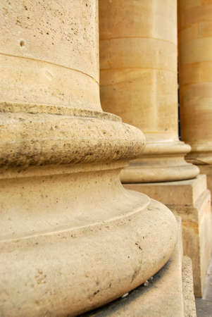 Closeup of row of stone columns in perspective photo