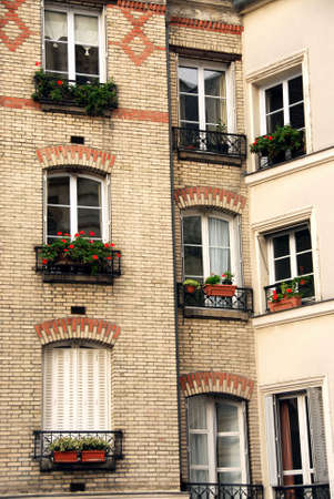 Windows of old apartment buildings in Paris France photo