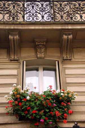 Windows and balconies of old apartment buildings in Paris France Banco de Imagens