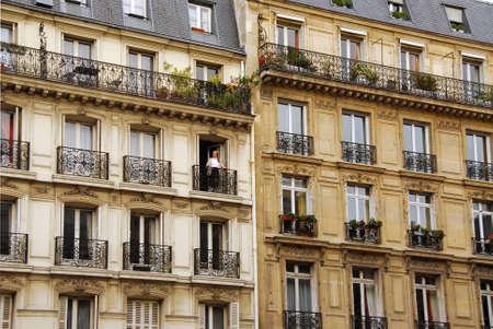 Windows and balconies of old apartment buildings in Paris France Stok Fotoğraf