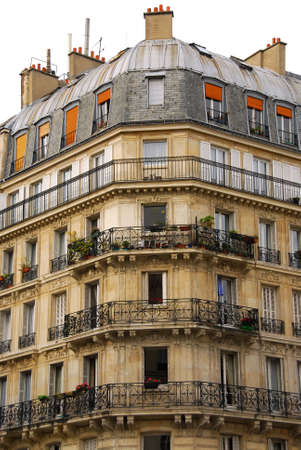 Old apartment buildings with wrought iron balconies in Paris France photo