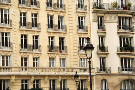 Windows and balconies of old apartment buildings in Paris France photo