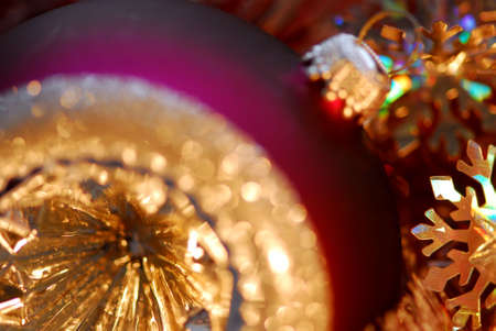 Closeup of purple christmas tree glass ball. Shallow dof, focus on the snowflake. photo