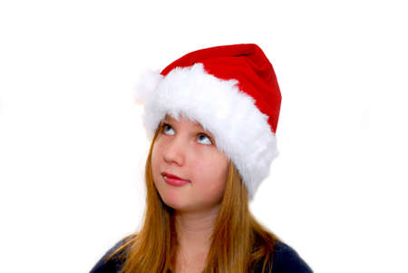Portrait of a young girl wearing Santa's hat isolated on white background Stock Photo - 623542