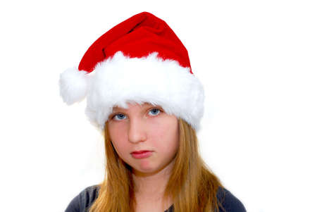 pouty: Portrait of a young girl wearing Santas hat isolated on white background Stock Photo