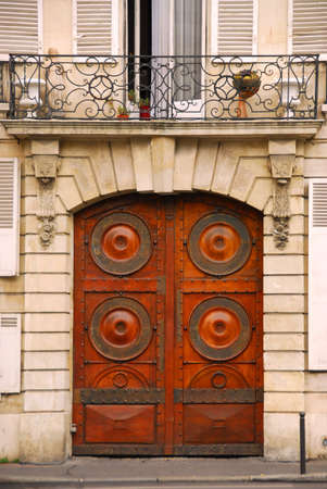 Wooden doors in old building in Paris France photo